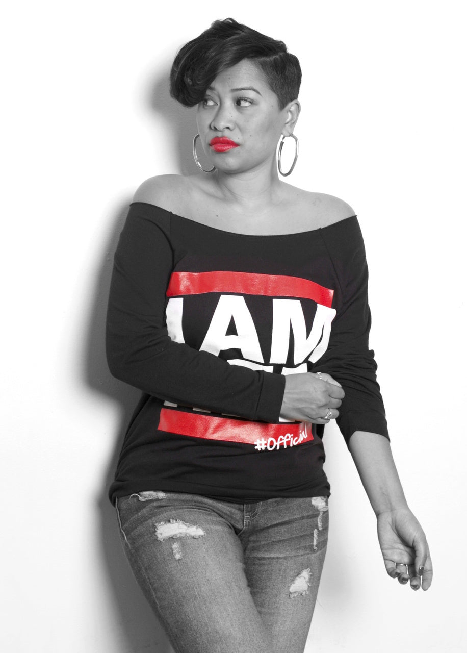 Female wearing black Women's Wideneck Off Shoulder with 3/4 sleeve for women with saying, I AM HER. For the girl who is unapologetically feminist and believes in girl power.