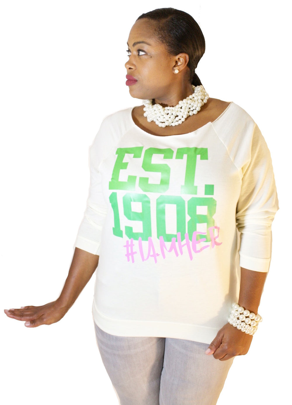 Black female wearing Ivory Women's Wideneck Off Shoulder with 3/4 sleeve for women with saying, EST. 1908 #IAMHER designed for the sisters of Alpha Kappa Alpha.