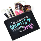Black canvas makeup bag with saying, He Gave Me Beauty for Ashes So I Slay for beauty essentials to organize beauty products, cosmetics and accessories.