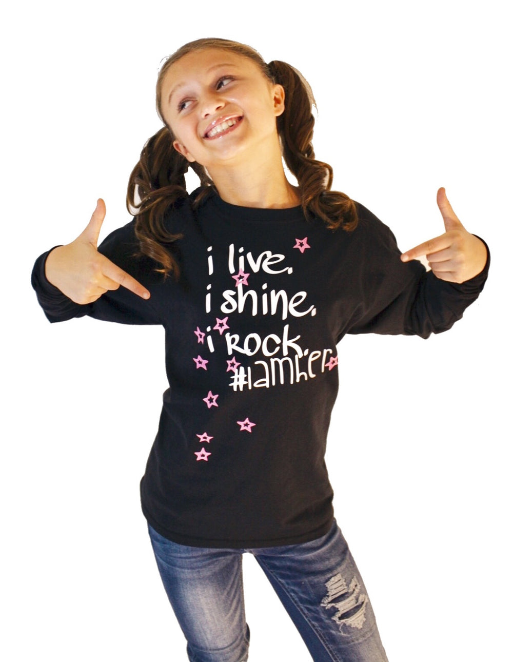 Girl wearing black longsleeve shirt for kids with saying, I Live. I Rock. I Shine #IAMHER. Girls fashion designed for her because it is never too early or too late for her to know her value and worth