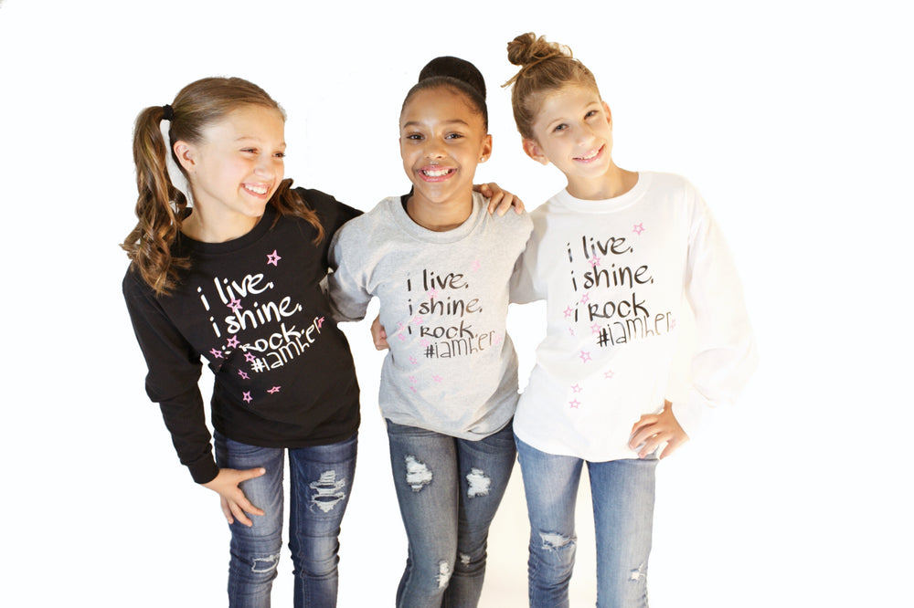 Girls wearing longsleeve shirts for kids with saying, I Live. I Rock. I Shine #IAMHER. Girls fashion designed for her because it is never too early or too late for her to know her value and worth