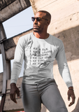Male wearing white Longsleeve shirt with saying for men, I AM A MAN. I AM A LEADER. I AM A STRONG. I AM THE HEAD. I AM KING. I AM HIM -­‐ 100% CERTIFIED. Longsleeve mens shirts for men who unapologetically shows up in the world with fashion.