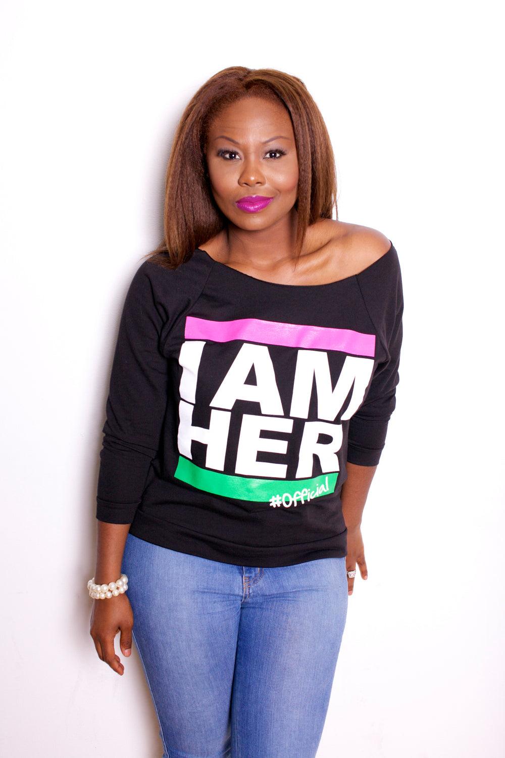 Female wearing Gray Women's Wideneck Off Shoulder with 3/4 sleeve for women with saying, I AM HER with pink and green bars. For the girl who is unapologetically feminist and believes in girl power.