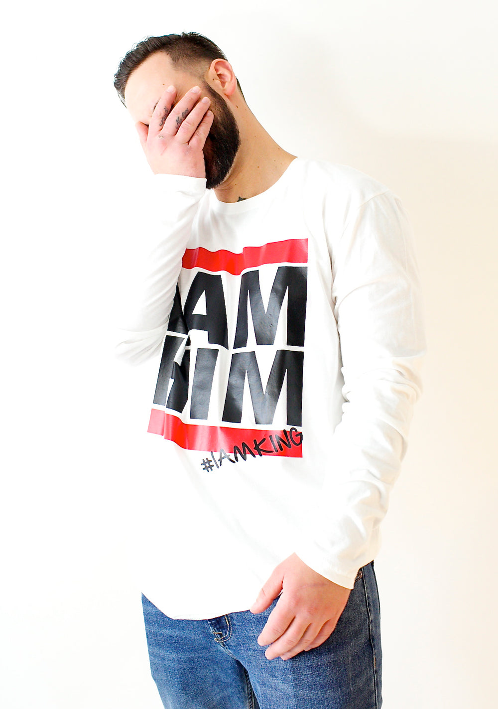 Male wearing white Longsleeve shirt with saying for men, I AM HIM. I AM KING. Longsleeve mens shirts for men who unapologetically shows up in the world with fashion.