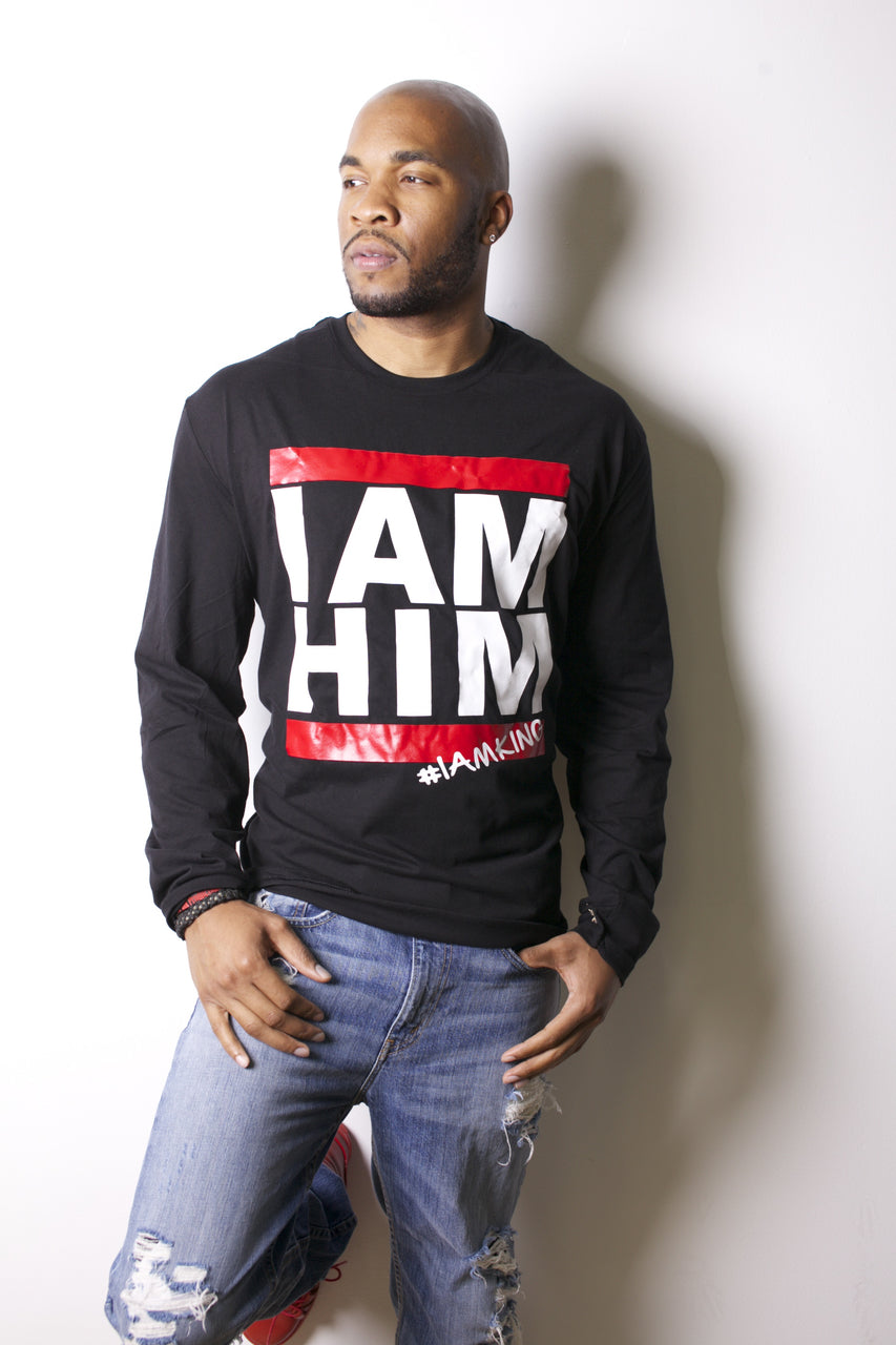 Male wearing black Longsleeve shirt with saying for men, I AM HIM. I AM KING. Longsleeve mens shirts for men who unapologetically shows up in the world with fashion.