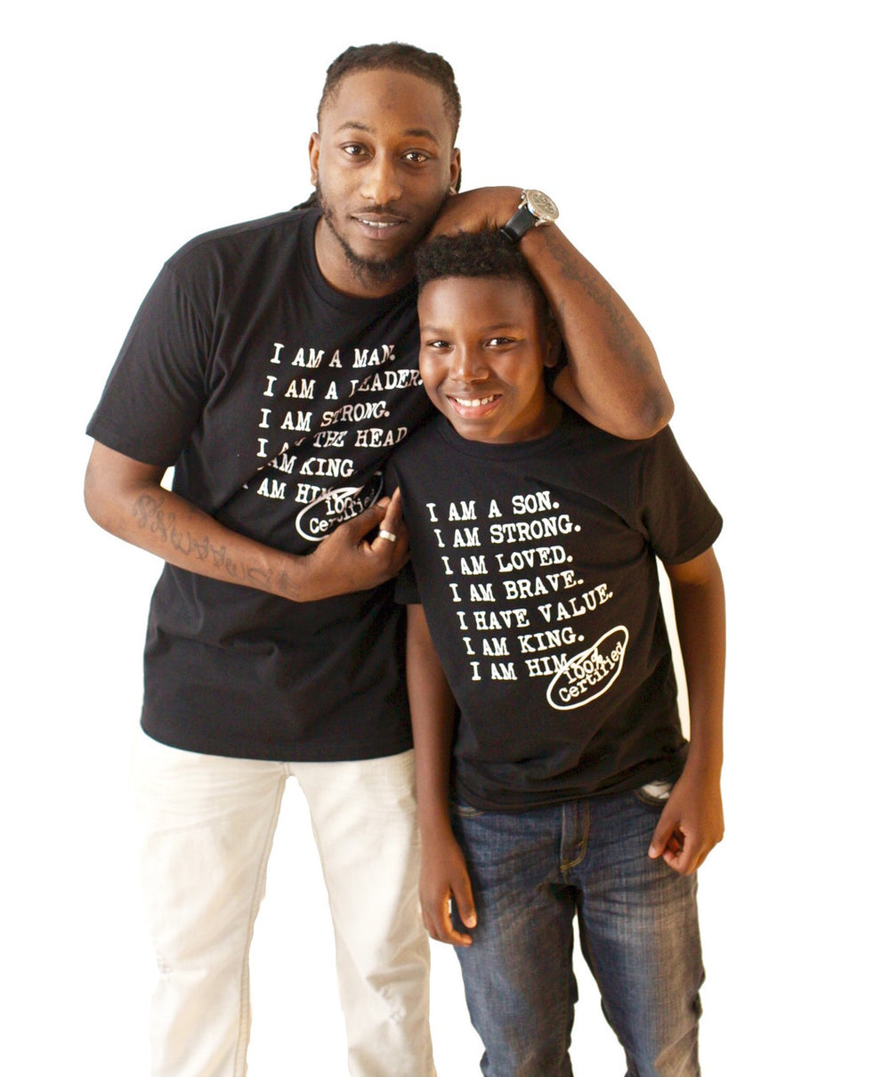 Two males wearing casual black t shirt with saying for men, I AM A MAN. I AM A LEADER. I AM A STRONG. I AM THE HEAD. I AM KING. I AM HIM -­‐ 100% CERTIFIED. Casual T Shirts for Men who unapologetically shows up in the world.