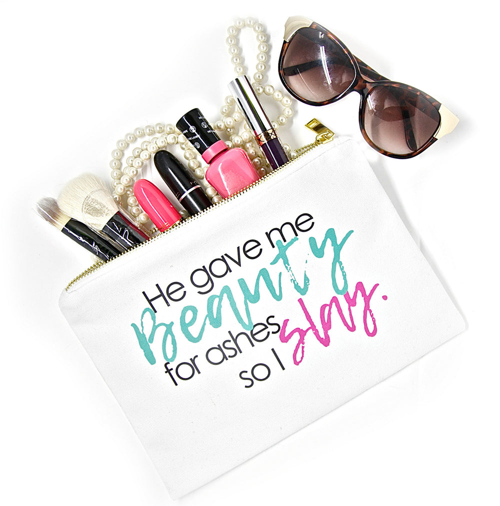 White canvas makeup bag with saying, He Gave Me Beauty for Ashes So I Slay for beauty essentials to organize beauty products, cosmetics and accessories.
