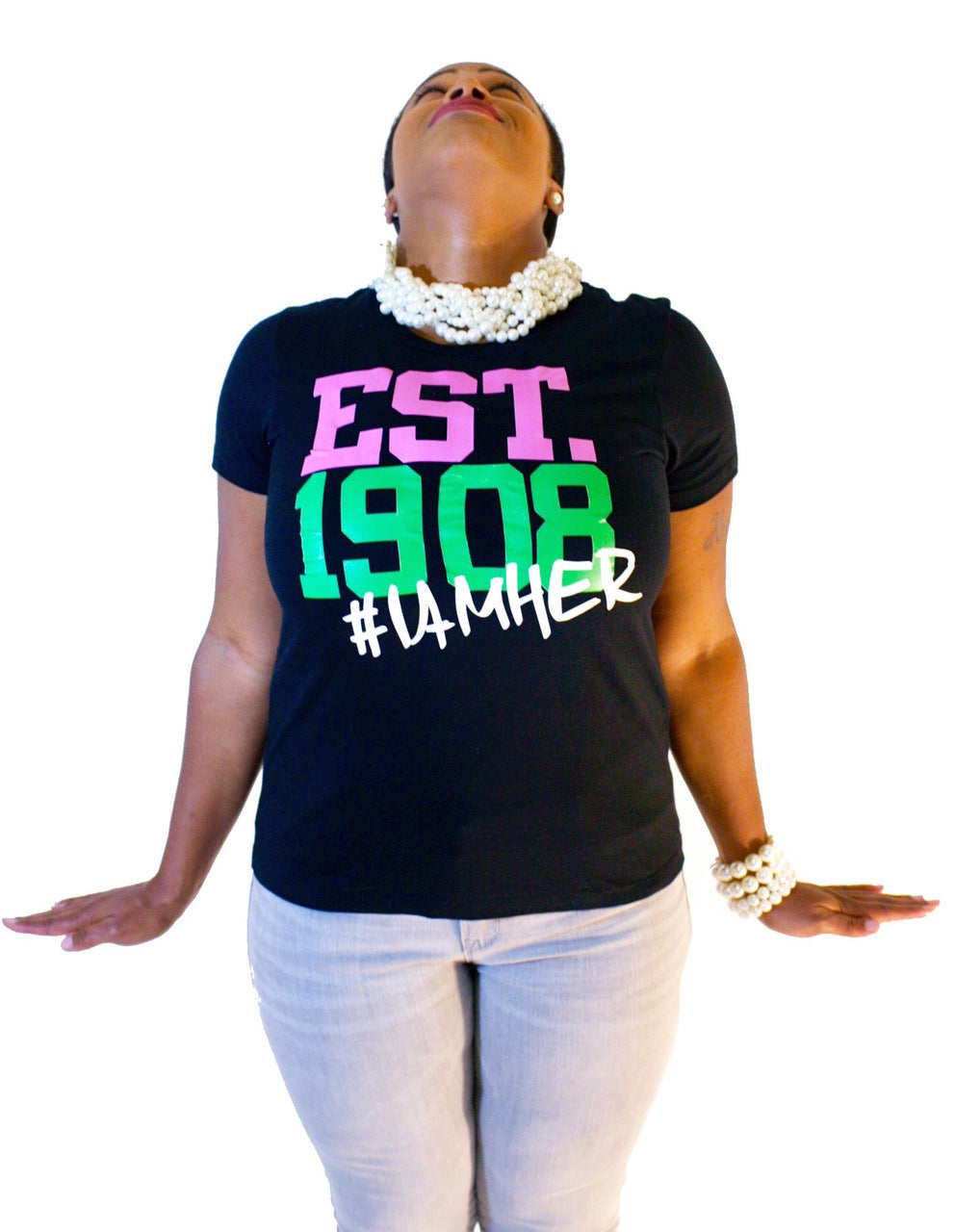 Black female wearing Black Graphic Tee for women with saying, EST. 1908 #IAMHER designed for sisters of Alpha Kappa Alpha.