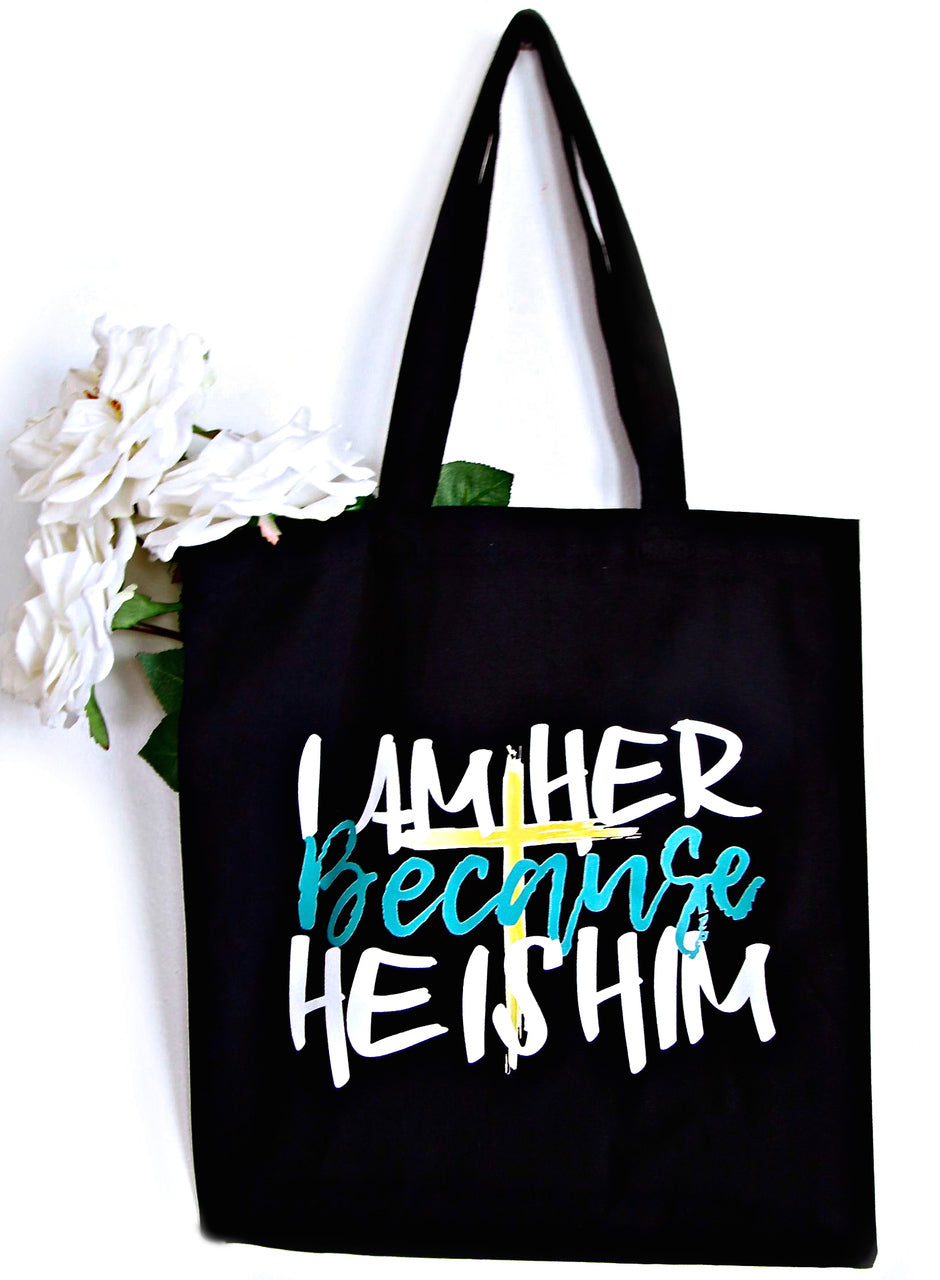 Black canvas tote bag with saying, I AM HER Because HE IS HIM in Mint writing. Cute fabric tote bag for accessories and essentials that cannot be placed in just any ol' shopping tote bag. For the Christian girl who is unapologetically a believer in Him