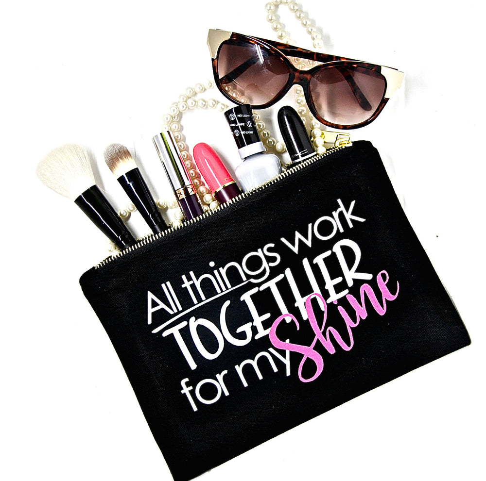 Black canvas makeup bag with saying, all things work together for my shine for beauty essentials to organize beauty products, cosmetics and accessories.