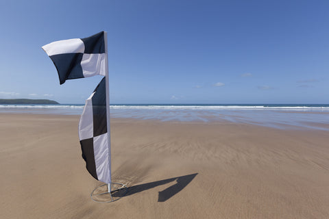 black and white beach warning flag