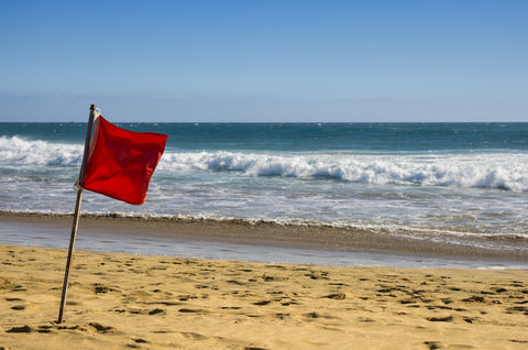 red beach warning flag