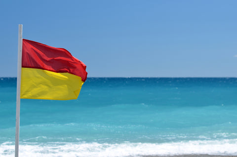 red over yellow beach flag