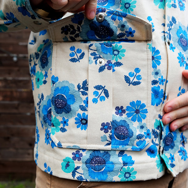 Blue floral jacket, front pocket closeup with flap open