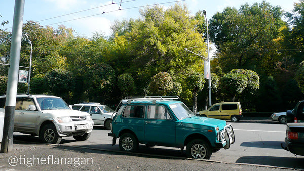 Teal Lada Niva parked on the street in Almaty, Kazakhstan.