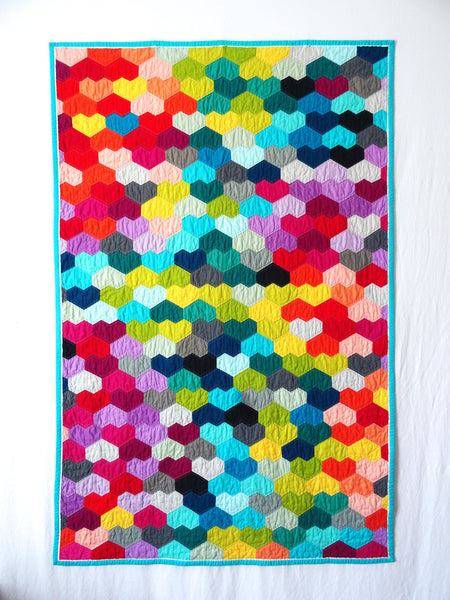 Heart quilt on white wall