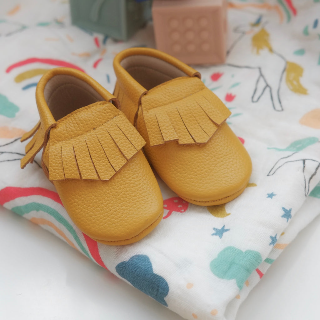 Mustard fringed moccasins