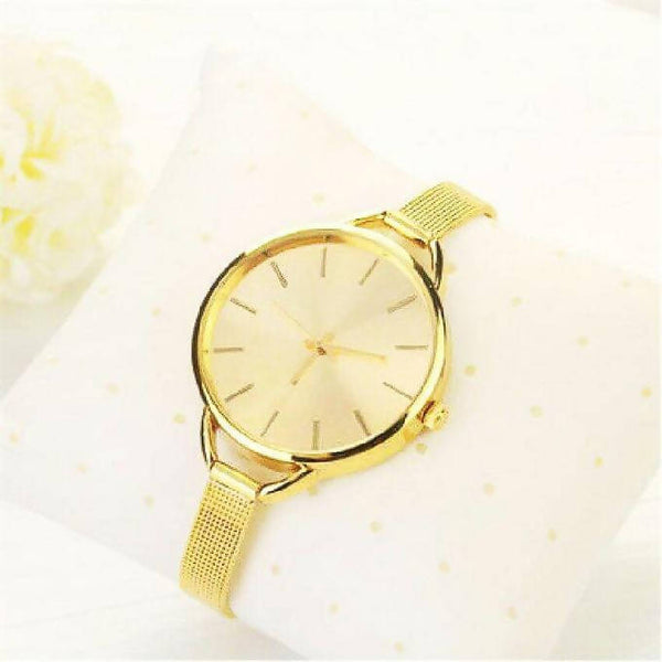 SLIM DESIGNER WOMEN'S WATCH - GOLD