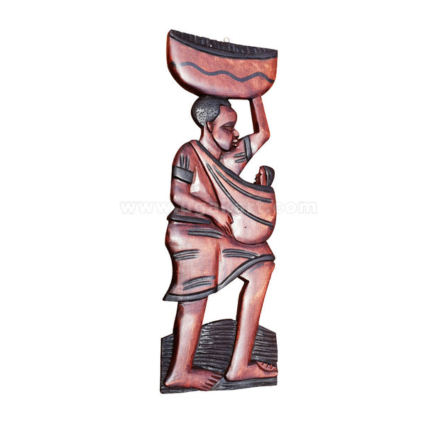 wooden sculpture with woman carrying baby and pot on head