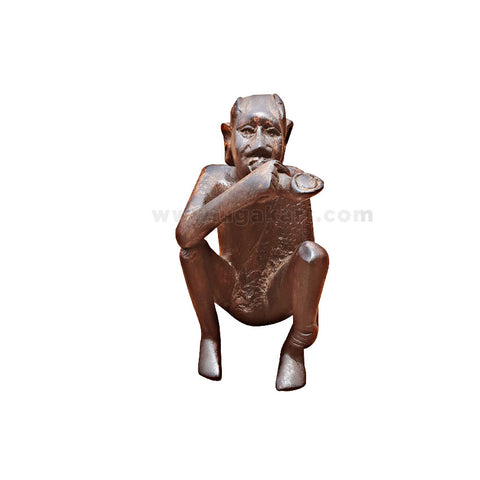 african man sculpture with smoking pipe