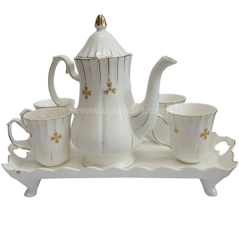 1 Tea Pot, Four Cups With Tray