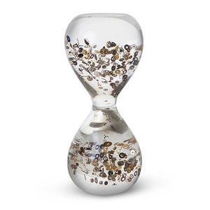 Large Passage Through Time by Berd Vaye shows vintage watch parts set in an acrylic hourglass.