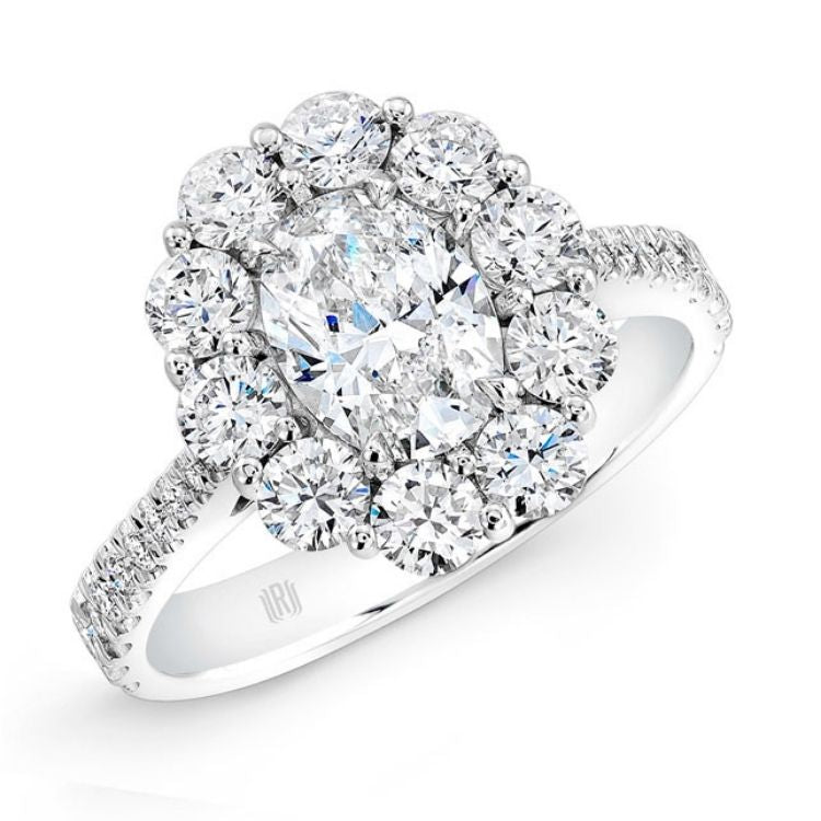 Oval diamond cluster halo engagement ring in 18k white gold