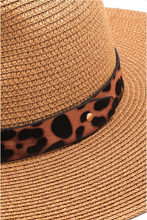 a tan straw color with leopard trim and a tall triangle crown.