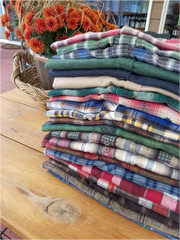 Stack of Flyshacker flannel shirts