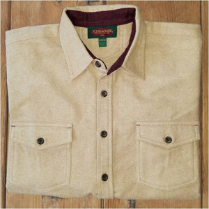 A folded Flyshacker flannel shirt, heathered chamois, camel