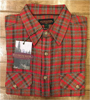 A folded Flyshacker flannel shirt, heritage, red heather and tan