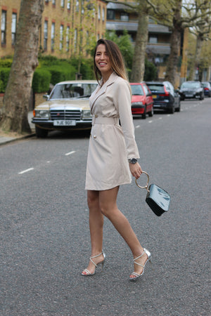 Long suit jacket with belt and coloured handbag
