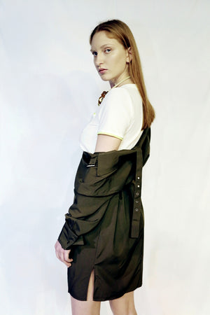 belted green dress with tshirt underneath