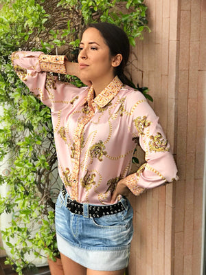 woman pink silk shirt