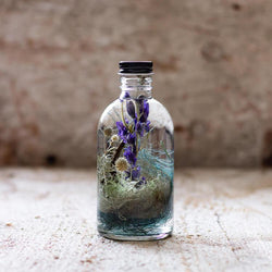 A dreamy blue botanical bottle, Reverie collection will inspire your artistic soul to be imaginative and create your own fantasy.
