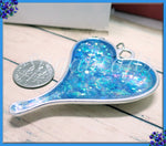 Pretty Shimmering Blue Heart Pendant in Silver