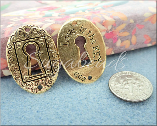 Love is the Key, Keyhole Pendant by Green Girl Studios
