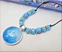 Lush blue and white Flower set in Silver Pendant