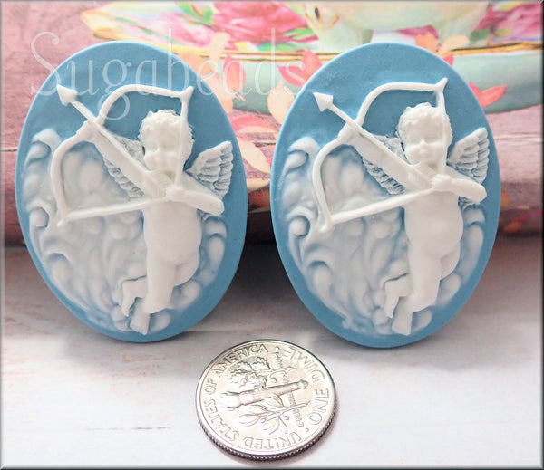 2 Oval Cupid Cameos, White on Blue Cameo