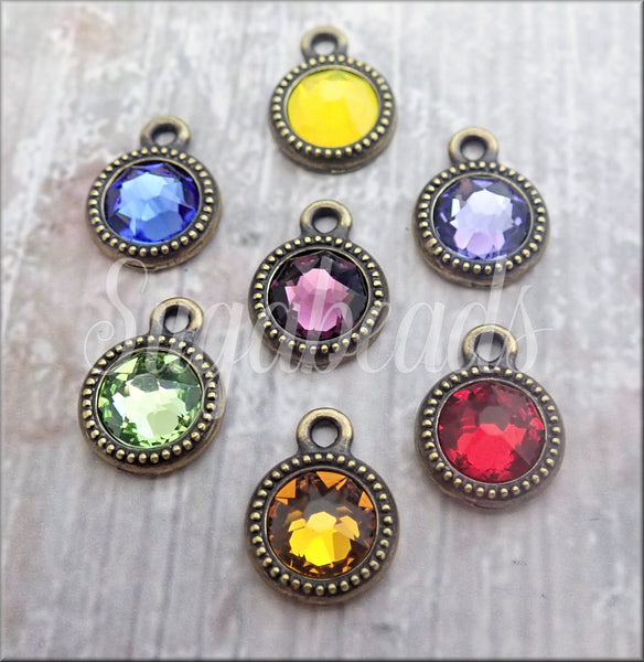 7 Oxidized Brass Plate Swarovski Crystal Chakra Charms by Tierra Cast