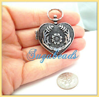1 Antiqued Silver Heart Locket with Flower Design 44m x 36mm PS31