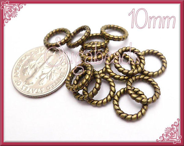 50 - Antiqued Brass  Twisted Jump Rings Closed 10mm JRT4 - sugabeads