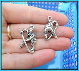 6 Antiqued Silver Ice Hockey Player Charms 26mm PS115
