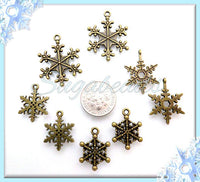 8 Mixed Snowflake Charms, Bronze Snowflakes, Antiqued Brass Winter Charms, PB49 - sugabeads