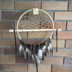 https://www.thesanctuarybne.com/products/painted-feathers-stick-dream-catcher-tba