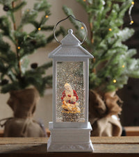 Santa With Baby In Manger White Glitter Water Lantern In Swirling Glitter - 131184