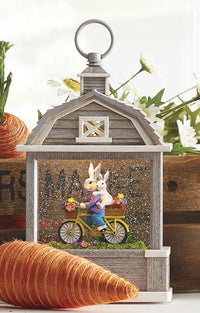 Bunnies On Bicycle Lighted Water Barn Lantern Battery Operated In Swirling Glitter With Timer - 4100751