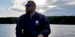Captain Greg Bailey sporting the Mary E jacket while sailing Mary E on the Kennebec River