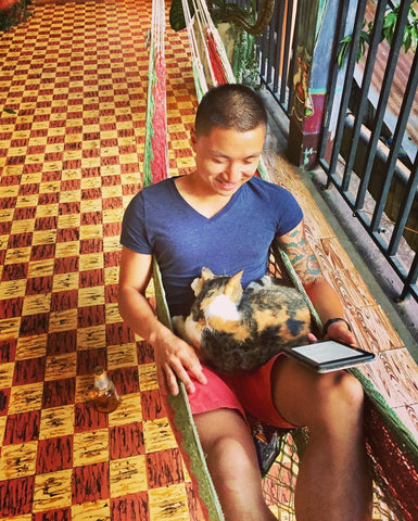Reading with a Hostel Cat