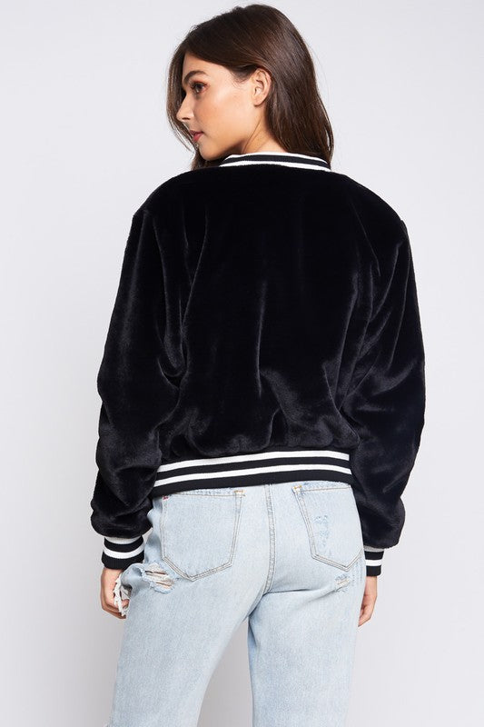 Meet Behind The Bleachers Varsity Jacket in Black